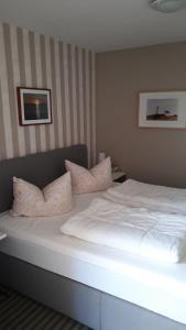 Ein Bett oder Betten in einem Zimmer der Unterkunft Fewo Kasch