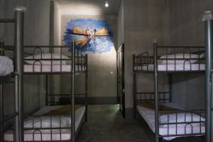 A bunk bed or bunk beds in a room at Shwe Yo Vintage Hostel
