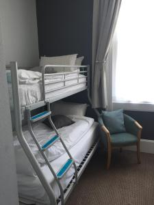 A bunk bed or bunk beds in a room at Tregonholme Hotel