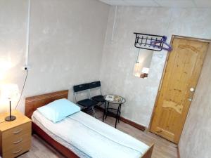 Кровать или кровати в номере Sim-Sim