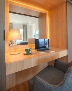 Телевизор и/или развлекательный центр в Fontana Hotel & Gastronomy