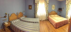 Un ou plusieurs lits dans un hébergement de l'établissement Hotel Xabier