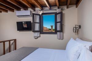 Säng eller sängar i ett rum på Zacosta Villa Hotel