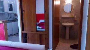 A bathroom at Studio & Rooms