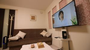 A seating area at COCO Shinjuku HOTEL