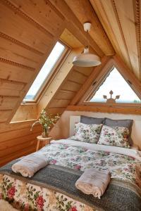 Łóżko lub łóżka w pokoju w obiekcie Gorce Oasis
