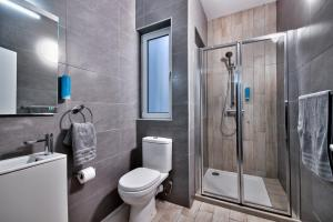 Salle de bains dans l'établissement Cozy Rooms Hotel