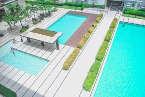 A view of the pool at Butler's BnB @ Trees Residences QC Phil or nearby