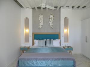 Ένα ή περισσότερα κρεβάτια σε δωμάτιο στο Selana Suites