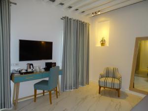 Μια τηλεόραση ή/και κέντρο ψυχαγωγίας στο Selana Suites