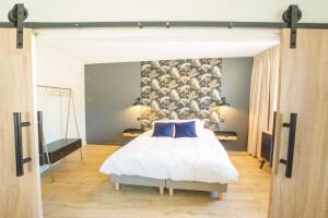 """A bed or beds in a room at """"Les Anges"""" Appartements d'Exception -Coeur de Ville-"""