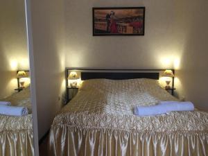 Кровать или кровати в номере 3-ком. квартира в курортной зоне