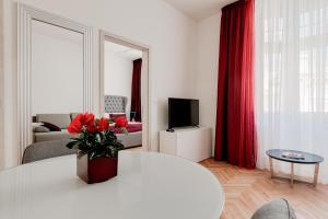 A television and/or entertainment center at Gold Art Apartments