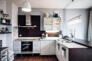 Кухня или мини-кухня в Ferienwohnung Stadtplatz 25