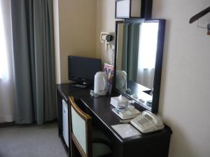 A television and/or entertainment centre at Takada Terminal Hotel