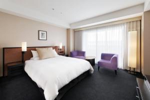 京都格蘭比亞大酒店房間的床