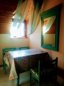 A bed or beds in a room at Lido Vendégház