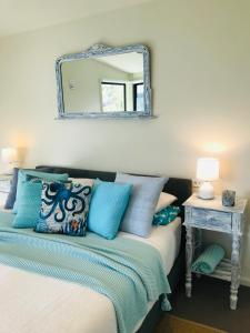A bed or beds in a room at Lorne Sea View Terrace house