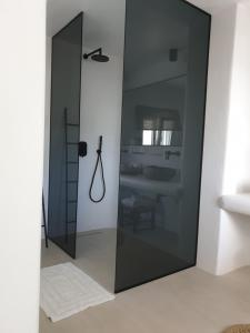A bathroom at Bellou Suites