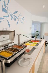 Η κουζίνα ή μικρή κουζίνα στο Alia Beach Hotel