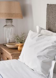 Uma cama ou camas num quarto em Quinta Da Comporta - Wellness Boutique Resort
