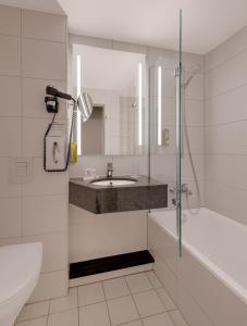 A bathroom at Best Western Hotel Darmstadt Mitte