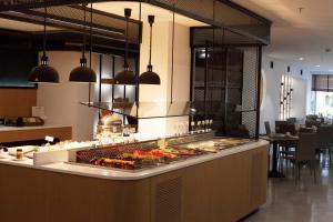 A kitchen or kitchenette at Capsis Astoria Heraklion