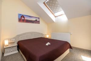 Posteľ alebo postele v izbe v ubytovaní Vila Gilė