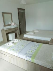 A bed or beds in a room at Vigla House