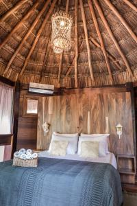 A bed or beds in a room at Origen Tulum