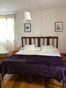 A bed or beds in a room at Casa Coll