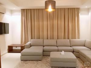 Uma área de estar em Villa Al Nakhil