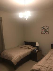 Cama ou camas em um quarto em Villa Al Nakhil