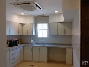 A cozinha ou cozinha compacta de Villa Al Nakhil