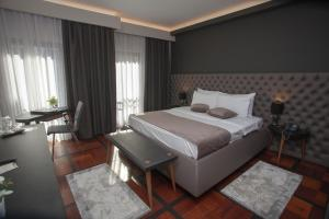 A bed or beds in a room at Solun Hotel & SPA