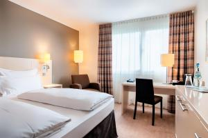 A bed or beds in a room at Select Hotel Mainz