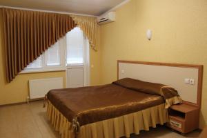Кровать или кровати в номере Гостиница Донская Волна