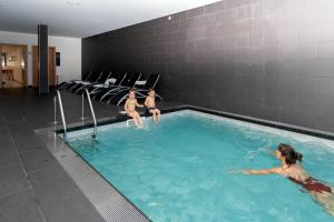 The swimming pool at or near Hotel da Fábrica
