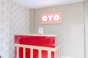 The lobby or reception area at OYO 1024 Palem Asri Residence Syariah