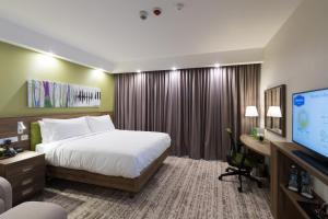A bed or beds in a room at Hampton By Hilton Kalisz