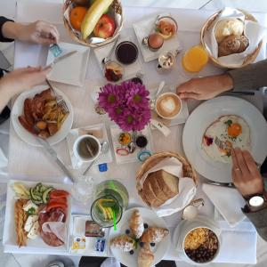 Breakfast options available to guests at Hotel Metropol