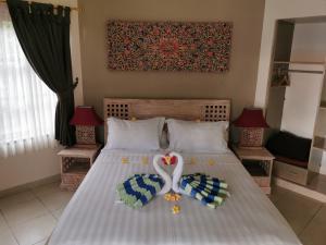 Un ou plusieurs lits dans un hébergement de l'établissement The Hamsa