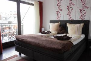 A bed or beds in a room at Budapest Center Residence