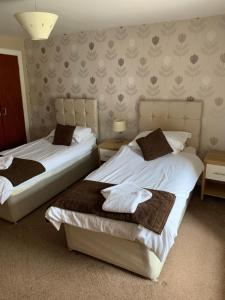 A bed or beds in a room at The White Swan Hotel