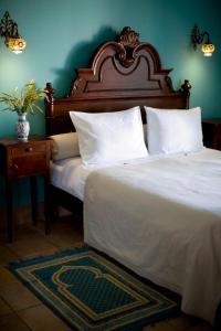 Кровать или кровати в номере Apart-Hotel Plantage
