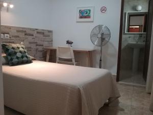 A bed or beds in a room at Hostal Residencia Cardona