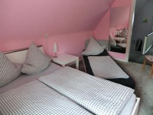Ein Bett oder Betten in einem Zimmer der Unterkunft Ferienwohnung Lange