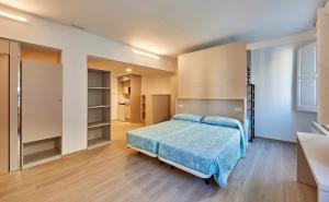 Een bed of bedden in een kamer bij Alberg Abat Oliba