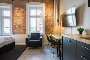 A kitchen or kitchenette at Loft Apartments Poznań