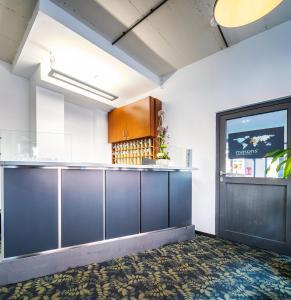 De lobby of receptie bij Schroeders City-Style-Hotel